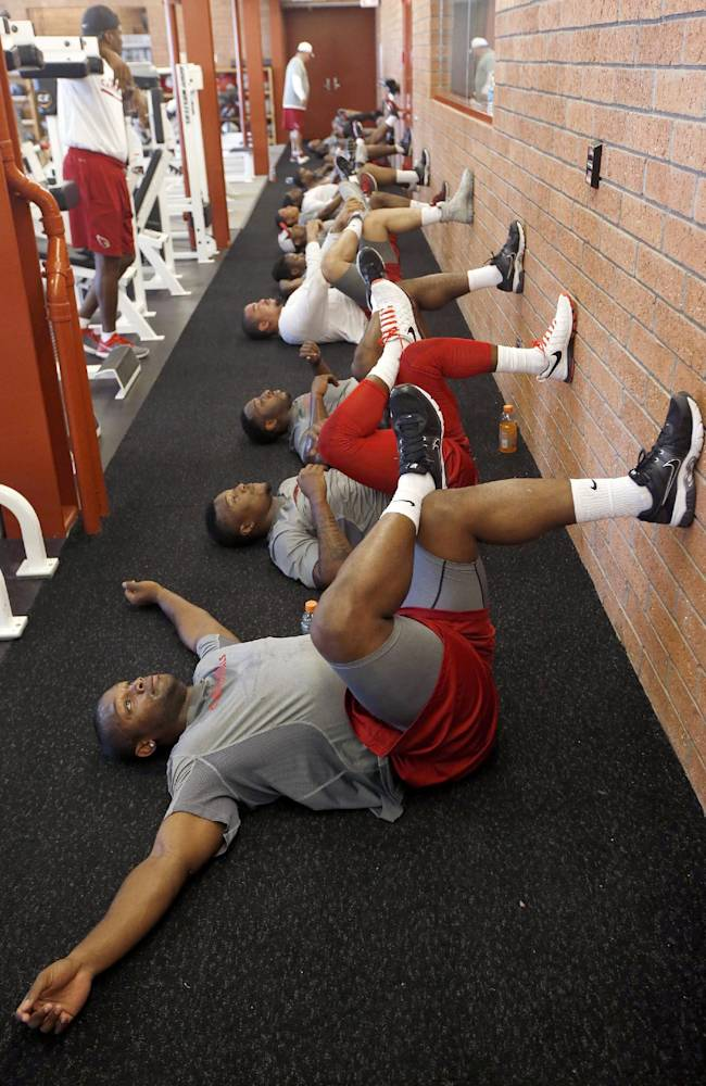 Jonathan Dwyer,Tony Jefferson and Stepfan Taylor, from front, work out with teammates during the first phase of the voluntary offseason training program at the NFL football team's training facility Thursday, April 24, 2014, in Tempe, Ariz