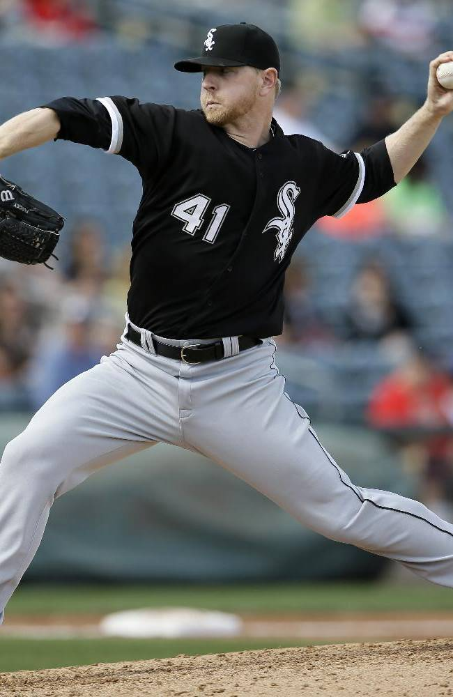 Chicago White Sox's David Purcey pitches to the Texas Rangers in the fifth inning of a spring training baseball game, Sunday, March 2, 2014, in Surprise, Ariz