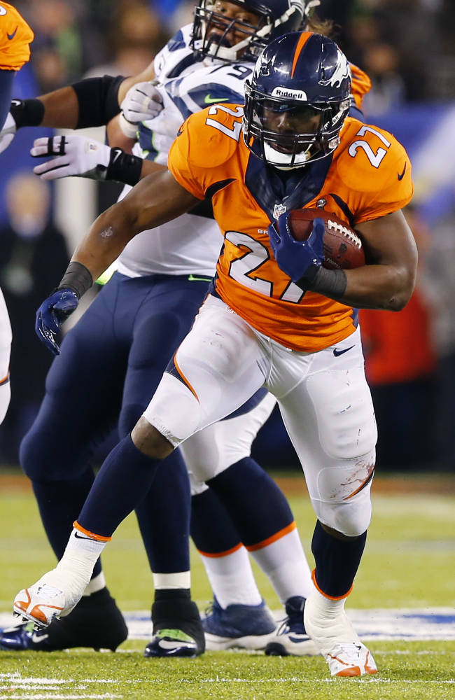 Denver Broncos' Knowshon Moreno runs with the ball against the Seattle Seahawks during the first half of the NFL Super Bowl XLVIII football game Sunday, Feb. 2, 2014, in East Rutherford, N.J