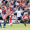 Southampton's Dusan Tadic fails to score while under pressure from West Bromwich Albion's Craig Dawson, left,, Saido Berahino and Andre Wisdom, right, during the English Premier League match at St Mary's, Southampton, England, Saturday Aug. 23, 2014