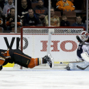 Anaheim Ducks right wing Corey Perry, left, scores past Columbus Blue Jackets goalie Sergei Bobrovsky during the first period of an NHL hockey game in Anaheim, Calif., Friday, Oct. 24, 2014. (AP Photo/Chris Carlson)