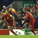 Liverpool's Steven Gerrard, left, celebrates with Jordan Henderson after scoring his side's first goal during the Champions League Group B soccer match between Liverpool and FC Basel at Anfield Stadium in Liverpool, England, Tuesday, Dec. 9, 2014