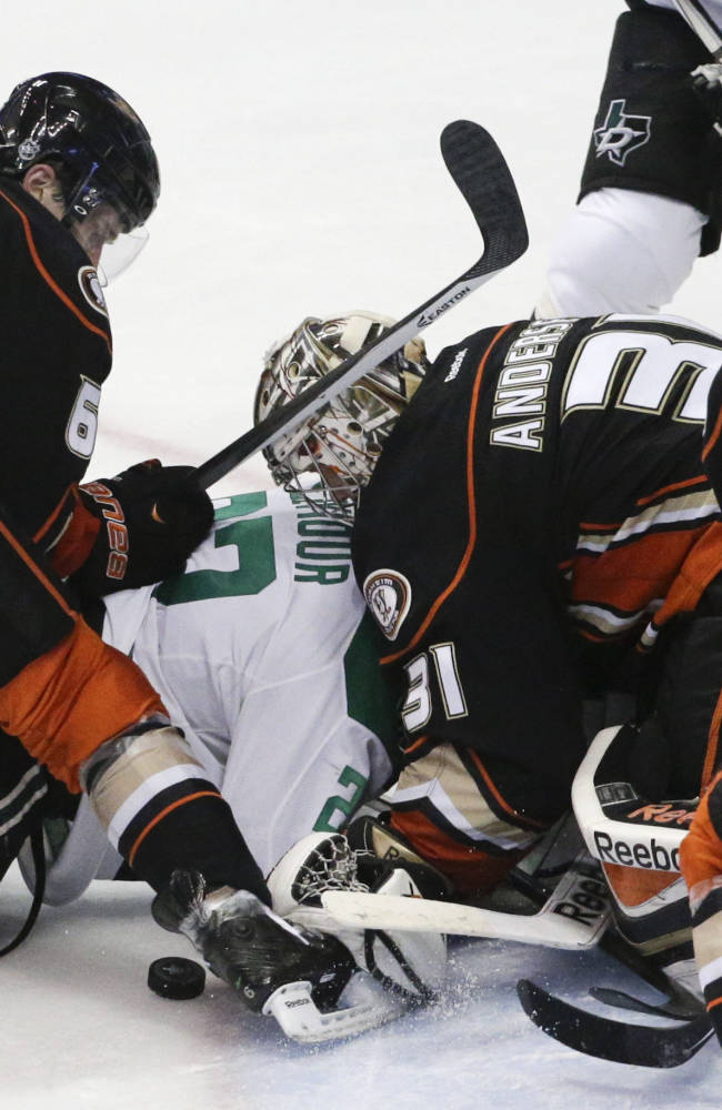 Dallas Stars' Colton Sceviour, center left, is pinned by Anaheim Ducks goalie Frederik Andersen, of Denmark, as Ducks' Ben Lovejoy, left, and Cam Fowler help defend during the second period in Game 2 of the first-round NHL hockey Stanley Cup playoff series on Friday, April 18, 2014, in Anaheim, Calif