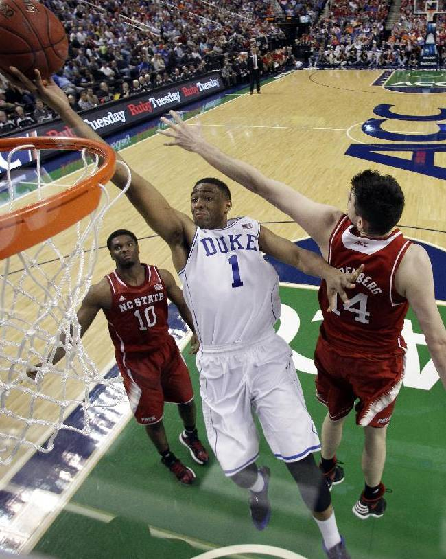 Duke's Jabari Parker (1) dunks past North Carolina State's Jordan Vandenberg (14) and Lennard Freeman (10) during the second half of an NCAA college basketball game in the semifinals of the Atlantic Coast Conference tournament in Greensboro, N.C., Saturday, March 15, 2014.  Duke won 75-67