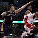 Toronto Raptors guard Terrence Ross, right, drives to the hoop past New Orleans Pelicans forward Luke Babbitt (8) during fourth quarter NBA action in Toronto, Monday, Feb. 10, 2014 The Associated Press