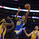 Golden State Warriors guard Kent Bazemore, center, puts up a shot as Los Angeles Lakers center Jordan Hill, left, and guard Jordan Farmar defend during the second half of an NBA basketball game, Friday, Nov. 22, 2013, in Los Angeles The Associated Press
