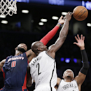With Detroit Pistons center Andre Drummond (0) defending, Brooklyn Nets forward Kevin Garnett (2) tries to tip a rebound to Brooklyn Nets forward Paul Pierce (34) in the second half of an NBA basketball game, Sunday, Nov. 24, 2013, in New York The Associa