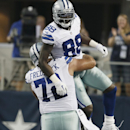 Dallas Cowboys wide receiver Dez Bryant (88) celebrates a touchdown with center Travis Frederick (72) during the first half of an NFL preseason football game against the Baltimore Ravens, Saturday, Aug. 16, 2014, in Arlington, Texas The Associated Press