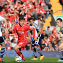 Liverpool's Adam Lallana, center, takes on West Bromwich Albion's Graham Dorrans, left, and Craig Gardner during their English Premier League soccer match at Anfield, Liverpool, England, Saturday, Oct. 4, 2014