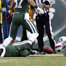 New York Jets quarterback Michael Vick (1) fumbles the ball during the first half of an NFL football game against the Buffalo Bills, Sunday, Oct. 26, 2014, in East Rutherford N.J. The Bills won the game 43-23 The Associated Press