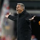 Sporting Kansas City head coach Peter Vermes yells to his team in the second half against the New York Red Bulls during an MLS playoff soccer match at Red Bull Arena in Harrison, N.J., Thursday, Oct. 30, 2014. The Red Bulls defeated Kansas City 2-1 The As