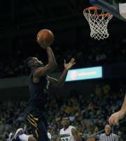 West Virginia's Juwan Staten (3) drives to the basket during the first half of an NCAA college basketball game against Marshall in Charleston, W.Va., on Saturday, Dec. 14, 2013. (AP Photo/Tyler Evert)