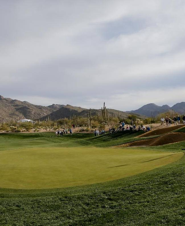 Jordan Spieth, right and Pablo Larrazabal,  of Spain, line up a putts on the third hole during the first round of the Match Play Championship golf tournament on Wednesday, Feb. 19, 2014, in Marana, Ariz