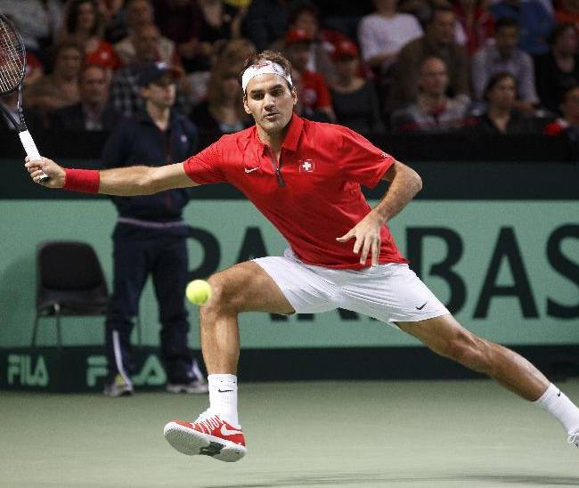 Roger Federer, of Switzerland, in action against Mikhail Kukushkin, of Kazakhstan, during the second single match of the Davis Cup World Group Quarterfinal match between Switzerland and Kazakhstan, at Palexpo, in Geneva, Switzerland, Friday, April 4, 2014. (AP Photo / Keystone, Salvatore Di Nolfi)
