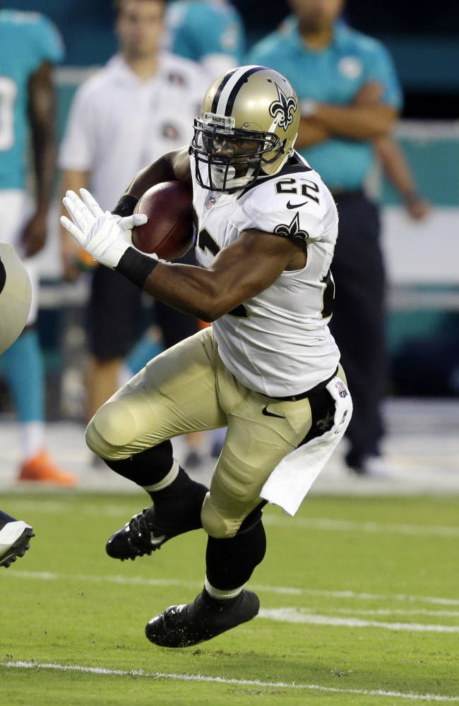 In this Aug. 29, 2013, file photo, New Orleans Saints running back Mark Ingram runs with the ball during the first half of an NFL preseason football game against the Miami Dolphins in Miami Gardens, Fla. Ingram says he's