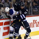 St. Louis Blues' Kevin Shattenkirk (22) is hit into the boards by Winnipeg Jets' James Wright (17) during second period NHL hockey action in Winnipeg, Tuesday, Dec. 10, 2013 The Associated Press