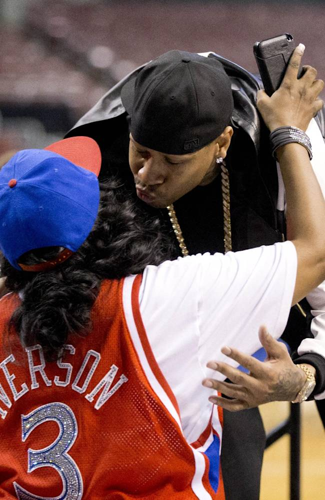 Former Philadelphia 76ers basketball player Allen Iverson greets his mother Ann Iverson as he arrives for a news conference Wednesday, Oct. 30, 2013, in Philadelphia. Iverson officially retired from thne NBA, ending a 15-year career during which he won the 2001 MVP award and four scoring titles. Iverson retired in Philadelphia where he had his greatest successes and led the franchise to the 2001 NBA finals