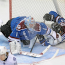 Colorado Avalanche center Maxime Talbot, right, slides into the goal past Avalanche goalie Semyon Varlamov, left, of Russia, in the first period of an NHL hockey game against the Tampa Bay Lightning, Sunday, March 2, 2014 in Denver The Associated Press