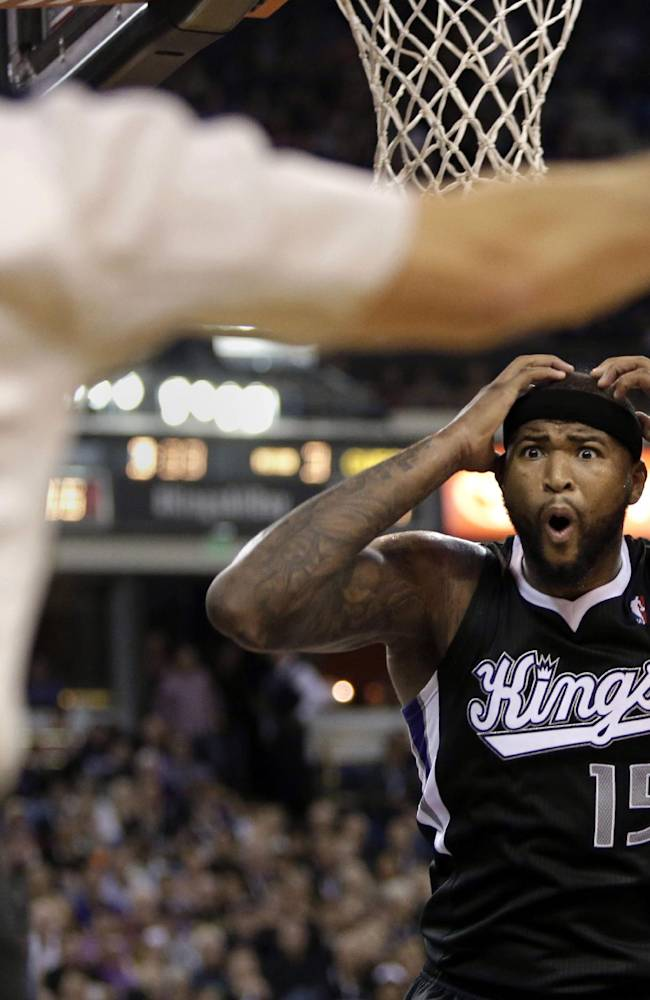 Sacramento Kings center DeMarcus Cousins (15) looks at official Scott Foster (48) after being called for a foul during the fourth quarter of an NBA basketball game against the Los Angeles Clippers in Sacramento, Calif., Friday, Nov. 1, 2013. The Clippers won 110-101