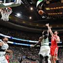 BOSTON, MA - JANUARY 30: Donatas Motiejuans #20 of the Houston Rockets goes up for a shot against the Boston Celtics on January 30, 2015 at the TD Garden in Boston, Massachusetts. (Photo by Brian Babineau/NBAE via Getty Images)