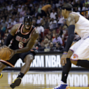 Miami Heat small forward LeBron James (6) drives as New York Knicks small forward Carmelo Anthony (7) defends during the first half of an NBA basketball game in Miami, Thursday, Feb. 27, 2014 The Associated Press