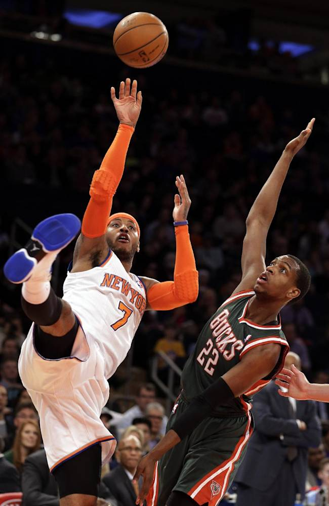 New York Knicks' Carmelo Anthony shoots the ball up against Milwaukee Bucks' Khris Middleton in the first quarter of an NBA basketball game at New York's Madison Square Garden, Saturday, March 15, 2014