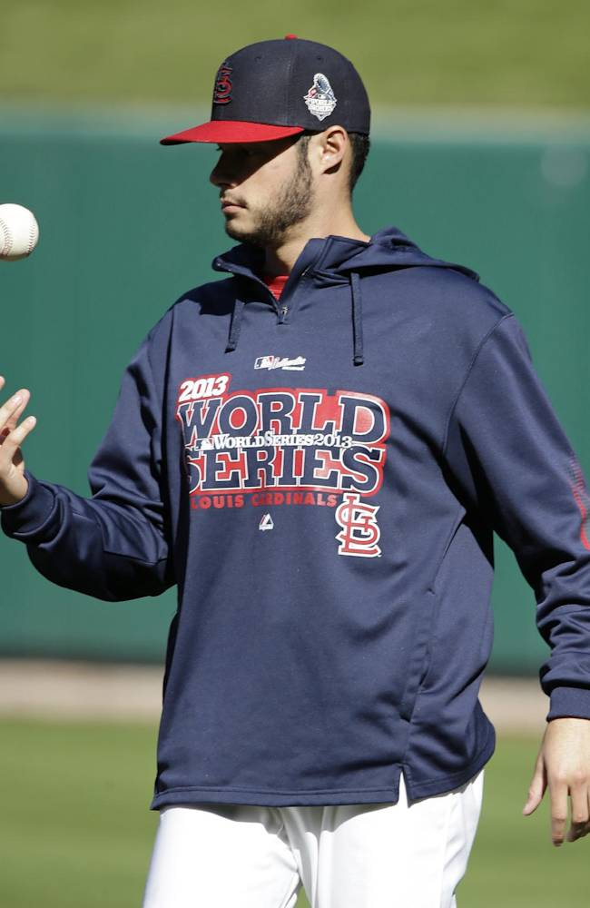 St. Louis Cardinals pitcher Joe Kelly tosses a ball before baseball practice on Friday, Oct. 25, 2013, in St. Louis. The Cardinals and the Boston Red Sox are set to play Game 3 of the World Series, Saturday in St. Louis