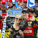 Brad Keselowski celebrates with his girlfriend, Paige White, holding a lobster, in Victory Lane after winning the NASCAR Sprint Cup Series auto race at New Hampshire Motor Speedway on Sunday, July 13, 2014, in Loudon, N.H. (AP Photo/Cheryl Senter)
