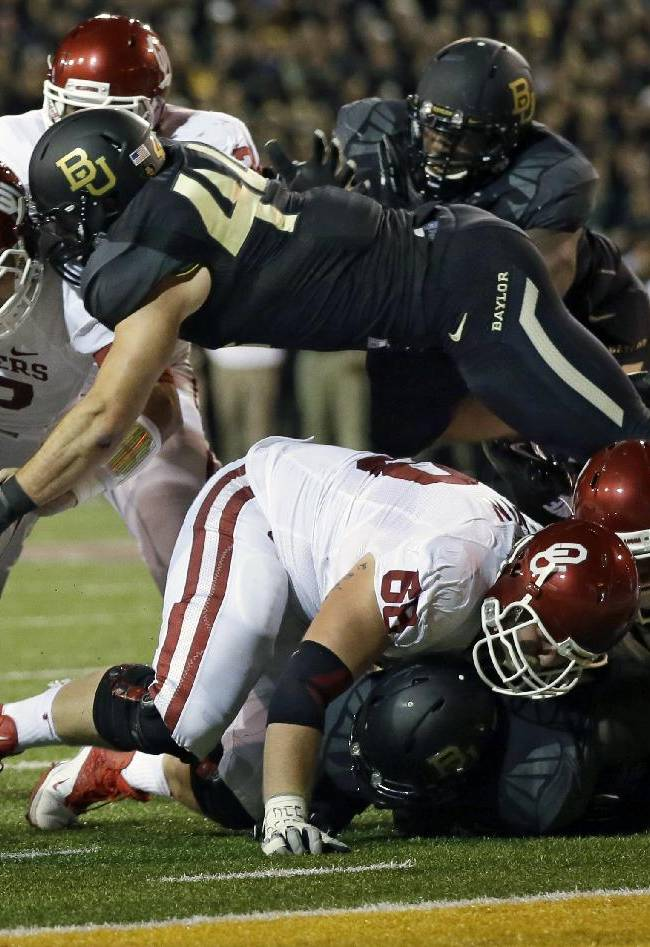 Oklahoma quarterback Blake Bell (10) is stopped on a fourth-and-goal play by Baylor 's Bryce Hager (44) in the first half of an NCAA college football game, Thursday, Nov. 7, 2013, in Waco, Texas. Oklahoma turned the ball over on downs
