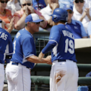 Kansas City Royals' Danny Valencia (19) is greeted by manager Ned Yost after scoring during the first inning of a spring exhibition baseball game against the Los Angeles Angels, Thursday, March 20, 2014, in Surprise, Ariz The Associated Press