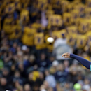 Seattle Mariners starting pitcher Felix Hernandez throws, with a backdrop of yellow