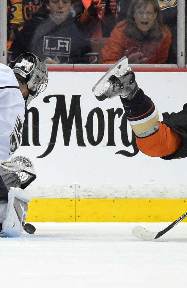 Los Angeles Kings goalie Jonathan Quick, left, stops a shot as Anaheim Ducks left wing Jakob Silfverberg, of Sweden, falls during the third period in Game 2 of an NHL hockey second-round Stanley Cup playoff series, Monday, May 5, 2014, in Anaheim, Calif. The Kings won 3-1