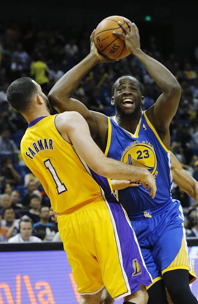 Draymond Green of Golden State Warriors, right, dives against Jordan Farmar of Los Angeles Lakers during a 2013-2014 NBA preseason game between Lakers and Warriors at Mercedes-Benz Arena in Shanghai, China, Friday, Oct. 18, 2013