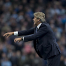 Manchester City manager Manuel Pellegrini gestures from the touchline as his team are beaten 2-0 by Newcastle during the English League Cup soccer match between Manchester City and Newcastle at the Etihad Stadium, Manchester, England, Wednesday Oct. 29, 2