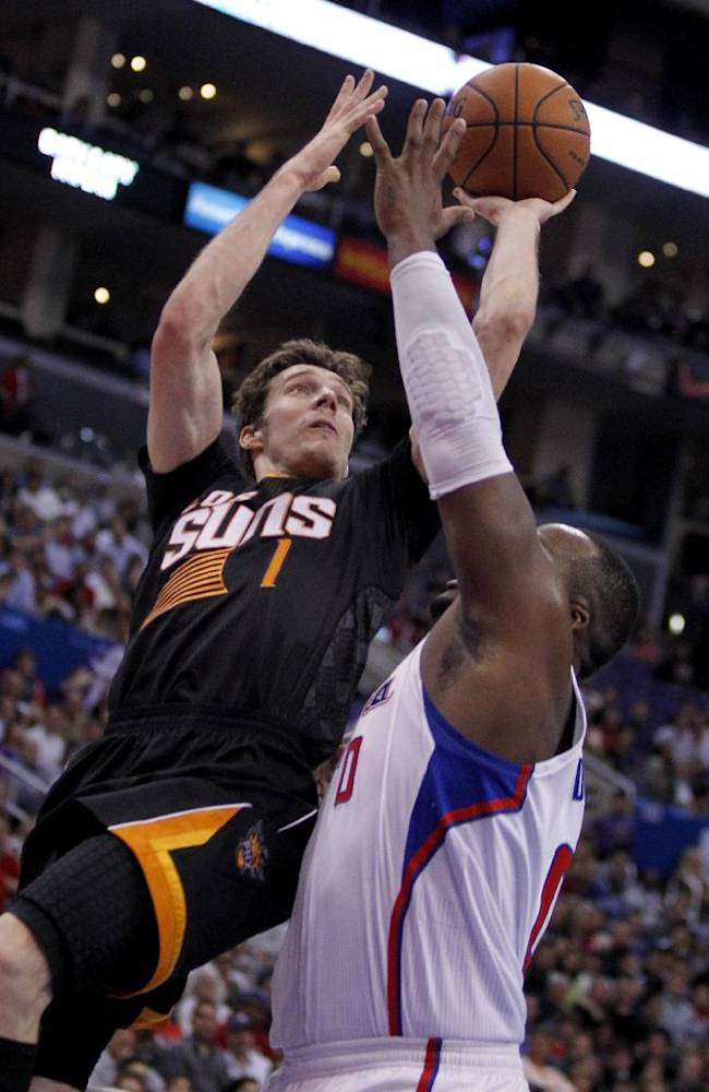 Phoenix Suns guard Goran Dragic (1), of Slovenia shoots over Los Angeles Clippers forward Glen Davis, right, during the second half of an NBA basketball game Monday, March 10, 2014, in Los Angeles. Clippers won 112-105