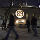 The No. 89 is illuminated on the facade of Soldier Field for former Chicago Bears player and coach Mike Ditka who will have his No. 89 retired during a halftime ceremony before an NFL football game between the Bears and Dallas Cowboys, Monday, Dec. 9, 201