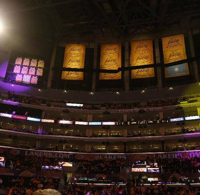 Los Angeles Lakers retired jersey numbers and championship banners are displayed inside the Staples Center before an NBA basketball game against the Los Angeles Clippers in Los Angeles, Tuesday, Oct. 29, 2013. The Clippers, who share the building with the Lakers, plan to hang banners of their own players in front of the Lakers' banners during their home games