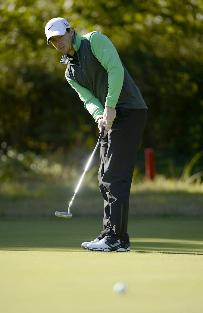 In this photo released by OneAsia, Rory McIlroy of Northern Ireland putts during the Pro-Am competition of the Korea Open golf tournament at Woo Jeong Hills Country Club near Cheonan, South Korea, Wednesday, Oct. 16, 2013