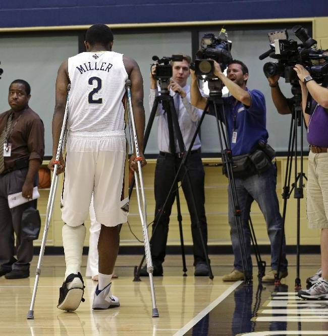 New Orleans Pelicans guard Darius Miller (2) walks towards reporters at their NBA basketball media day in Metairie, La., Monday, Sept. 30, 2013