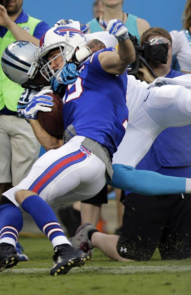 Buffalo Bills' Chris Hogan, front, is tackled by Carolina Panthers' Thomas DeCoud, back, during the first half of a preseason NFL football game in Charlotte, N.C., Friday, Aug. 8, 2014