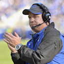 Kentucky head coach Bob Stoops appalauds his team's effort during the first quarter of an NCAA college football game against Mississippi State at Commonwealth Stadium in Lexington, Ky., Saturday, Oct. 25, 2014. Mississippi State won 45-31. (AP Photo/Timothy D. Easley)