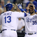 Kansas City Royals' Salvador Perez (13) celebrates his two-run home run with Eric Hosmer (35) in the sixth inning during a baseball game against the Detroit Tigers, Saturday, Sept. 7, 2013, in Kansas City, Mo. (AP Photo/Ed Zurga)