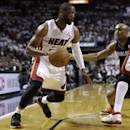 Miami Heat's Dwyane Wade, left, drives as Charlotte Bobcats' Gerald Henderson, right, defends during the first half in Game 2 of an opening-round NBA basketball playoff series, Wednesday, April 23, 2014, in Miami. (AP Photo/Lynne Sladky)