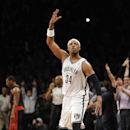 Brooklyn Nets' Paul Pierce (34) celebrates his three-pointer against the Toronto Raptors that put the Nets in the lead 97-94 in the second half of an NBA basketball game on Monday, March 10, 2014 at Barclays Center in New York. The Nets won 101-97 The