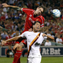 Liverpool FC defender Daniel Agger, top, challenges AS Roma's Marco Borriello (9) for the ball during a friendly soccer match at Fenway Park in Boston, Wednesday, July 23, 2014. (AP Photo)