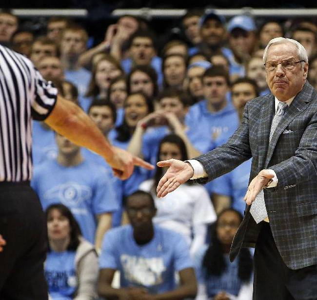 North Carolina head coach Roy Williams protests a call with an official during the first half of an NCAA college basketball game against the Pittsburgh in Chapel Hill, N.C., Saturday, Feb. 15, 2014. North Carolina won 75-71