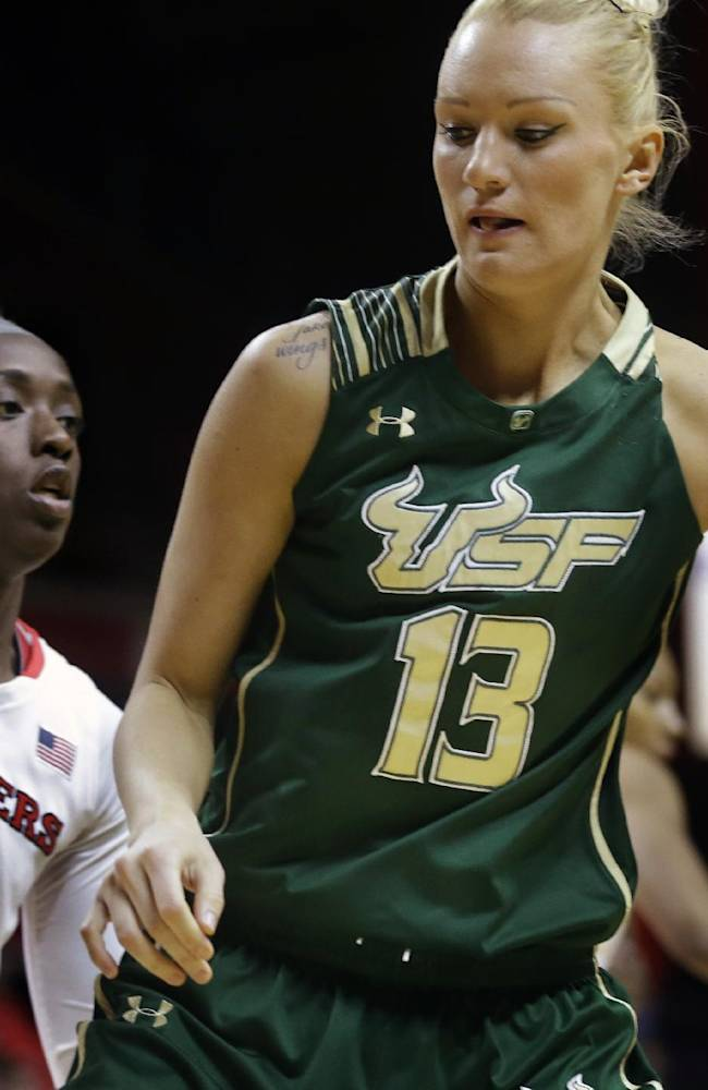 South Florida guard Inga Orekhova (13), of Ukraine, dribbles the ball in front of Rutgers  forward Kahleah Copper (2) during the first half of an NCAA college basketball game Monday, March. 3, 2014, in Piscataway, N.J