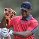 Tiger Woods takes the driver from his bag on the eighth hole during the final round of the PGA Championship golf tournament at Oak Hill Country Club, Sunday, Aug. 11, 2013, in Pittsford, N.Y. (AP Photo/Julio Cortez)