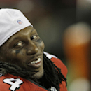 In this Aug. 8, 2013 file photo, Atlanta Falcons wide receiver Roddy White (84) smiles on the sideline during a preseason game against the Cincinnati Bengals in Atlanta. On the eve of training camp, the Falcons have agreed to terms on a new contract with