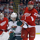 Minnesota Wilds' Matt Moulson (26) tangles with Detroit Red Wings' Brian Lashoff (23) during the first period of an NHL hockey game Sunday, March 23, 2014 in Detroit. Moulson scored the game-winning goal in overtime to defeat the Red Wings 4-3 The Associa
